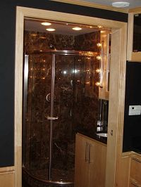 Bathroom w/gorgeous chocolate marble shower and black granite counter